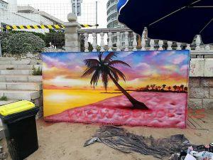 graffiti playa Sitges amanecee puesta sol